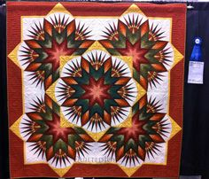 Crimson Radiance by Charlotte McRanie and Shannon Baker.  2012 Mid-Atlantic Quilt Festival.