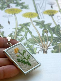 cross stitch embroidered  pendant with   yellow flower