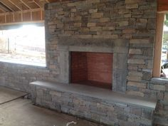 Stone fireplace in pool cabana nantucket