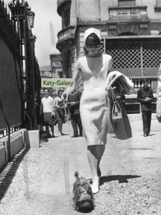 """Audrey Hepburn photographed with Assam of Assam doing her shopping in Madrid, in May 1962. thefashionofaudrey  Dress: Givenchy (silk linen, ivory, sleeveless, Spring/Summer of 1961). Sunglasses: Oliver Goldsmith (created especially for Audrey in 1956. The same that she wore in """"Breakfast at Tiffany's""""). Handbag: Hermès. Shoes: René Mancini  Dress: Givenchy (silk linen..."""