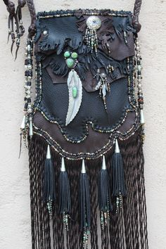 Jessie western unique sterling silver feathers,emerald turquoise , hand cut Fringes and Tassels. Made by Carole Hook for Jessie Western, Portobello Rd. London.