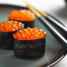 ikura nigiri - a strip of nori with ikura (salmon roe). | The most well-known sushi is the oval shaped sushi, called nigiri-zushi which means hand-pressed sushi.