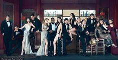 The lady In Black: Vanity Fair-Hollywood 2011 Oscar hosts Anne Hathaway and James Franco join 13 other Hollywood stars in elegant Vanity Fair fold-out cover