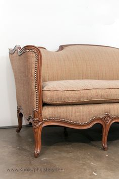 Antique Italian love seat with down seat cushion and nail head trim.