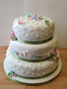 3 Tier Shabby Chic Inspired Wedding Cake Bunting Blossoms and Lace Work Piping- Green, Yellow, Blue and Pink  https://www.facebook.com/photo.php?fbid=564420003597116=936b756de6