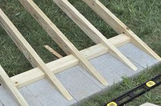 There are lots of high-quality sheds available, but one thing commonly not included is the shed ramp. Fortunately, anyone can learn how to build a shed ramp Wood Shed Plans, Shed Building Plans, Storage Shed Plans, Building A Deck, Building Design, Building Ideas, Concrete Sheds, Shed Ramp, Shed Construction
