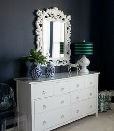 IKEA Hemnes dresser with high-gloss ornate white mirror. The white really pops against the navy walls!