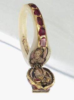 Locket ring of Queen Elizabeth I. (gold with enamel, rubies, diamonds & mother-of-pearl). The top portrait is likely of her mother, Ann Boleyn, the other is a profile of Elizabeth herself.