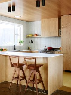 Kitchen details. Bar stools designed by TH Brown circa 1960 and Australian made Comcork (rubber and cork compound) sheet flooring in 'safely yellow'. Photo – Eve Wilson. Production – Lucy Feagins / The Design Files.