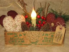 Cheese box with fabric hearts, candles greenery, tag and a doily. Really pretty valentine decoration.
