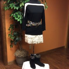 LUCCA COUTURE WINTER WHITE FEATHER SKIRT This is super cute with the layers of fringed material down the skirt. It is a mini and is NWOT COLOR IS WINTER WHITE Lucca Couture Skirts