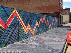 fence weaving. could use plastic bags to create art