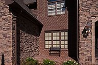 The beauty is in the details; this brick home features stack bond framed window openings and a mortared paver system in an eye-catching herringbone pattern. What else can you do with brick? http://insistonbrick.com/