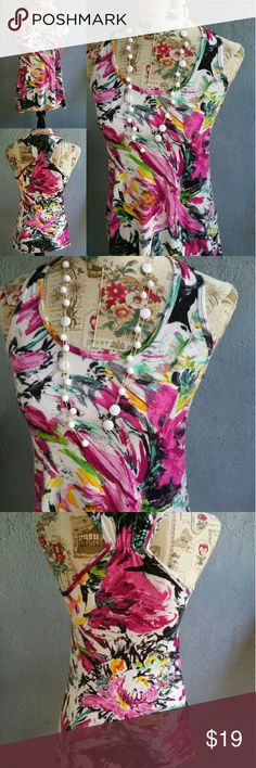"""Body Central Floral Racerback Tunic Top Body Central Floral Racerback Tunic Top size S. In excellent used condition. Cotton spandex blend. Very comfortable and chic. Pairs great under a Blazer, Utility Jacket or by itself. Very versatile. Flat lay measurements : 24"""" length / 14.5"""" bust. Has alot of stretch to it. Please let me know if you have any questions. 30% discount when using the bundle feature. No trades! Body Central Tops"""
