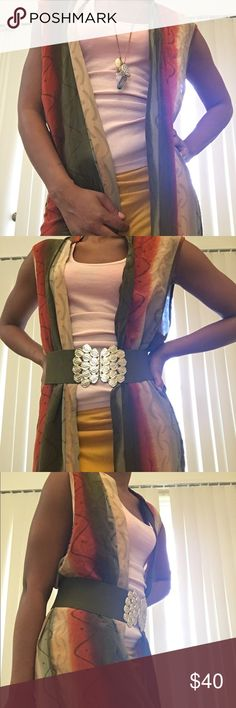 100% SILK LONG VEST Multi-colored silk vest sz M small flaw on right shoulder(in pic) nice as statement piece for outfit or a cover up for the beach. Too big for me Other