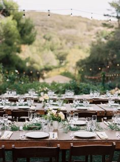 Rustic meets boho outdoor reception: http://www.stylemepretty.com/california-weddings/malibu/2016/05/20/think-your-bridesmaids-cant-wear-white-think-again/ | Photography: Mariel Hannah - http://www.marielhannahphoto.com/
