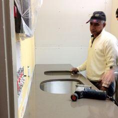 Sink, dishwasher area getting installed.