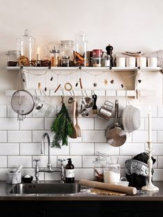 the open shelf with a rod underneath to hang stuff on it?