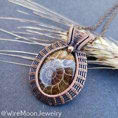 This stunning ammonite I wrapped in copper sold during the holiday rush. Gosh, I loved making this one! 🐚