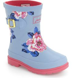 Cheery blooms liven up this handmade, puddle-ready rubber rain boot featuring a cute buckle-tab detail. Mixed treads offer excellent traction on wet and dry surfaces.