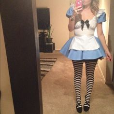 Alice In Wonderland Halloween Costume Super cute halloween costume! Worn once ... Comes with black tutu, stripped thigh highs, two black headbands. As is no returns Dresses