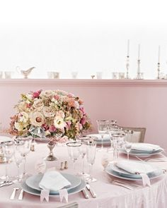 Romantic Centerpiece  Old-fashioned flowers, including blush and taupe roses, ivory tuberose, and dusty miller, combine to create an arrangement that speaks of centuries-old gardens. Jasmine tendrils and hot-pink roses add a hint of boldness.