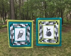 "[COMMUNITY SUBMISSION] These two amazng quilts were submitted by @quiltswithwolves. Ellen shared this about these beautiful quilts: ""I made these two quilts for my niece who is expecting twin boys in July. She lives in Phoenix, Arizona and loves to hike! The nursery's theme is adventure in the outdoors. The center panels and the black and whit strips pieced around the panels are from Moda's Thicket line. I added American Made solids alternating turquoise and bright green with a narrow black…"