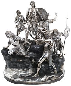 A VICTORIAN SILVER AND PATINATED BRONZE RACING TROPHY, HANCOCKS & CO, FROM DESIGNS AND MODELS BY RAPHAEL MONTI, LONDON,  1875  the rocky bronze base applied with seven silver groups or figures, lapping waves and shrubs