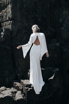 modern backless wedding dress with bell sleeves by Prea James http://wedding-dress-tips.us