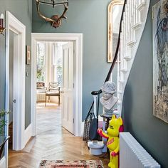 Lovely colour scheme and flooring.Traditional hallway staircase and parquet flooring- west London home House Tour by Livingetc Hallway Colours, Room Colors, Hallway Colour Schemes, Paint Colours, Color Schemes, Grey Hallway, Hallway Ideas Entrance Narrow, Modern Hallway, Blue Hallway Paint