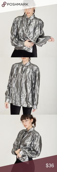 """90s metallic top Vintage '90s silver metallic button down blouse from Evan-Picone. This will fit multiple sizes depending on desired look. Made in USA.   EXCELLENT CONDITION  MEASUREMENTS  •Size marked 10 •Bust 44"""" •Waist 42"""" •Length 26.5"""" •Sleeve Length 23.5"""" •Shoulder seam 2 seam 16""""  ALL PHOTOS ARE ORIGINAL &  OF THE ACTUAL ITEM BEING SOLD. No trades or holds. All items will ship within 1-2 days of purchase. Vintage Tops Button Down Shirts"""