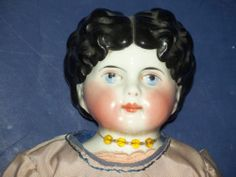 LOVELY ANTIQUE GERMAN CHINA HEAD DOLL WITH SILK DRESS, COLORFUL LOWER LEGS