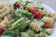 Caesar Pasta Salad - OK, well I had to tweek this a bit and it's NOW amazing.. brought to work for potluck and everyone loved it.. !!!!  Love Mojo!