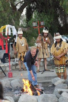 Director Jonathan Salisbury throws a piece of bark into the fire, upon which is written his old name. Jonathan was honored in receiving a Tongva name from the Gabrieleno-Tongva San Gabriel Band of Mission Indians for his work with them on the 2013 re-imagining of The Mission Play, and Toypurina. Jonathan was give the name 'North Star Speaks With Wisdom'.