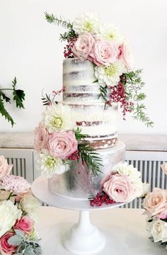 A beautiful mix of naked, rustic cake and the trendy metallics! Adorned with gorgeous and lush flowers.