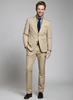 Tan summer suit by Bonobos with grey shirt and dark tie. Sharp cut with a casual sensibility.