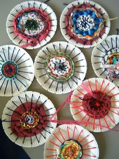 weaving with kids - paper plate weaving  NO DIRECTIONS GIVEN  (use heavy paper plates for this or the plate will buckle)