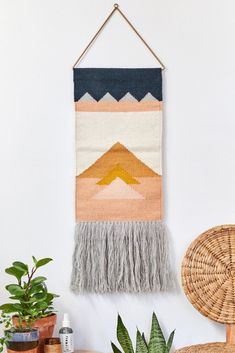 Shop Cleo Wall Hanging at Urban Outfitters today. We carry all the latest styles, colors and brands for you to choose from right here. Weaving Textiles, Weaving Patterns, Tapestry Weaving, Loom Weaving, Hanging Tapestry, Bead Patterns, Weaving Wall Hanging, Quilted Wall Hangings, Cortina Floral