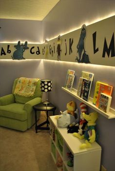 Dr. Seuss-themed nursery. DIY paneling, backlit with rope lighting; hand-painted Seuss characters.