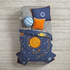 "Let the countdown to bedtime begin. Our out-of-this-world Solar System quilt features our eight official planets orbiting the sun. Feeling sorry for Pluto? We've paid homage to the cute dwarf planet in a top-of-the-bed, reversible throw pillow. Complete the universe with our Stars and Orion's Sheet Sets. Don't forget a ""Blast-Off"" throw pillow.<br /><br /><NEWTAG/><h2>Details, details</h2><ul><li> Designed by Michael Mabry</li><li> Quilt is 200-thread count</li><li> Quilt is hand quilted…"