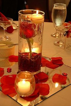 cool and relatively inexpensive; ask venue if they have the mirror tiles and votives (most do). then you only need to supply the flower in a tall glass vase with the glass beads and flower petals