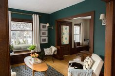 Teal living room with the dark wood and WHITE furniture - LOVE. Scandinavian Mid Century Modern house, Minneapolis / Apartment Therapy