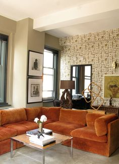 "Graphic wall paper, modern sculpture, burnt orange crushed velvet sectional - this is my 1970's dream home. From Design Sponge's ""The Best of Orange"" series."