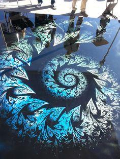 Reflector metallic epoxy by Ryan Samford of Epo Floors - like a chambered nautilus in metallics!