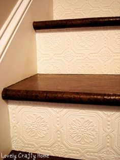 Textured Wallpaper on stair risers. A great way to add texture and design to a small space! This might be a cheap way to make my stairs better until I cough up the large sum of money for the redecorating