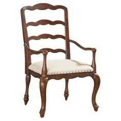 """Bring stately style to your dining room or home office with this elegant vintage cherry-finished arm chair, showcasing an upholstered seat with nailhead trim, cabriole legs, and a scalloped ladder back.   Product: ChairConstruction Material: Cherry wood solids, veneers and fabricColor: Vintage cherryFeatures:  25"""" Arm heightNailhead trimDimensions: 43"""" H x 24"""" W x 24"""" DAssembly: Simple assembly required"""