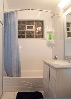 Marshmallow Corner Wall Storage Overlooking With Curvy Light Blue Shower Curtain In Tiny Bathroom Remodel Colleen Rotator Rod
