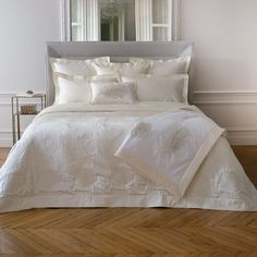 PalmBay Bed Linens ensemble combines jacquard woven items, quilted and embroidered pieces all centered around the palm leaf design. Ivory colorway.