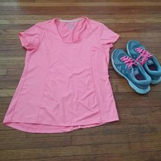 Marika tee. Bright coral Marika tee. Dry wik. Perfect for any workout or outdoor activity. Tops Tees - Short Sleeve