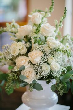 Flowers from my very own wedding day! Soft, blush roses, white spray roses with seeded eucalyptus and baby's breath.